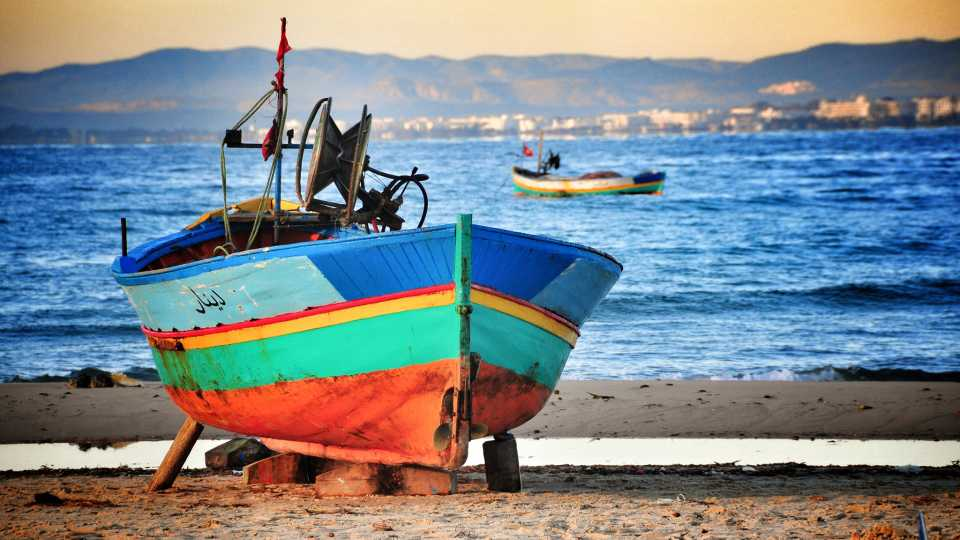 Fishing boats in Tunisia are very colorful, this one on the beach in Hammamet.