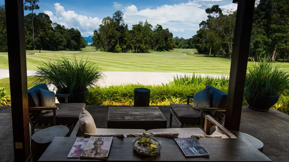 Relax after your round in the open air clubhouse with a view of the 18th green.