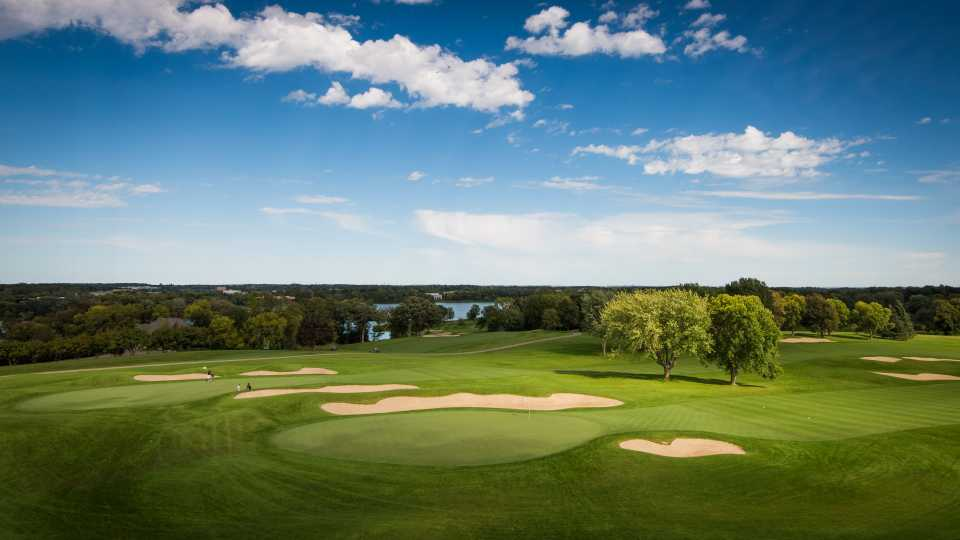 View of the 9th and the 18th holes at Hazeltine National, with the Minneapolis skyline in the distance.