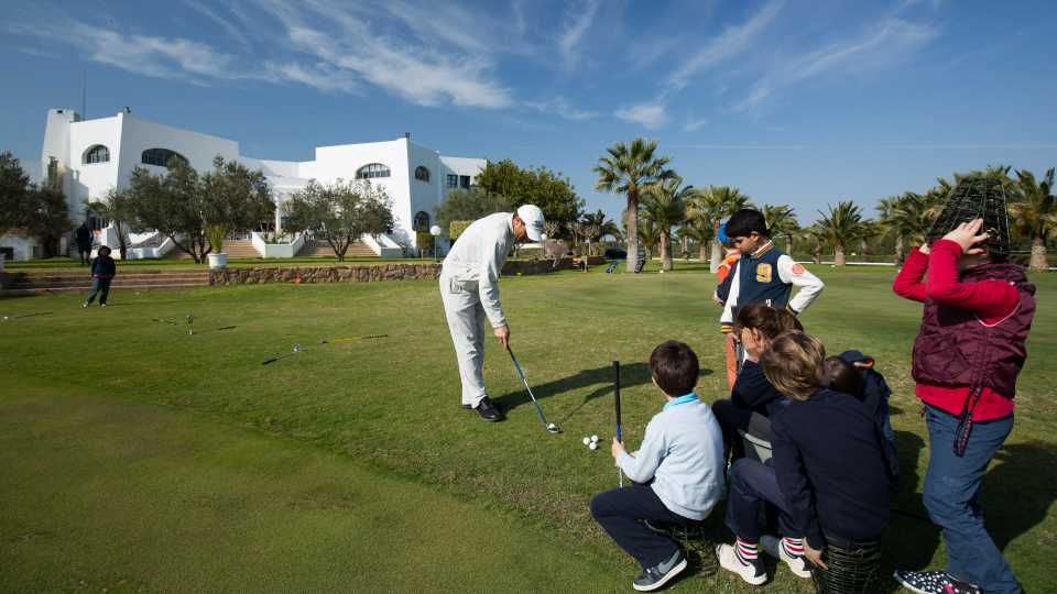 Junior golfers at Citrus have fun on the practice greens.