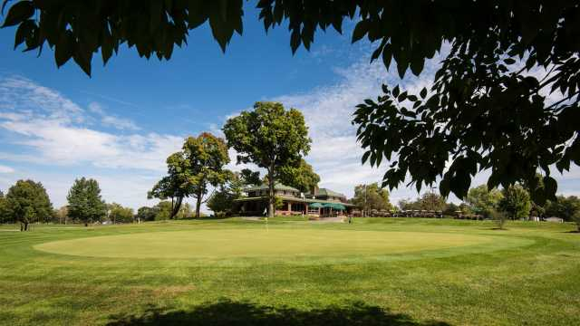 The 18th green with the clubhouse in the background.